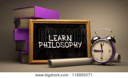 Hand Drawn Learn Philosophy Concept on Chalkboard.
