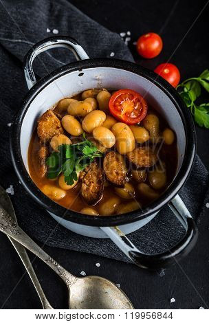 Hot Baked Beans With Tomato And Parsley In Pot