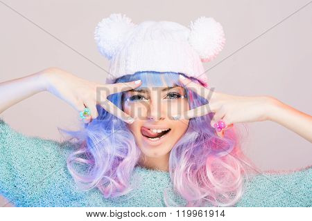 Modern cute young woman in white beanie with pastel pink and blue hair