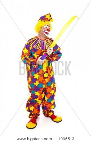 Clown blows up a special balloon for making balloon animals.  Full body isolated on white.