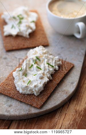 Sandwiches with cream cheese and coffee