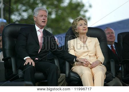 NEW YORK - JUNE 25: Former U.S. President Bill Clinton (L) and his wife, U.S. Senator Hillary Clinton (D-NY), attend the Greater New York Billy Graham Crusade June 25, 2005 in Flushing, New York.