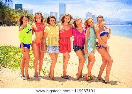 Closeup Cheerleaders In T-shirts Bikinis Stand In Line On Beach