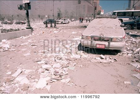 NEW YORK - SEPTEMBER 11:  Ash covers an emergency vehicle as it lies near the area known as Ground Zero after the collapse of the Twin Towers September 11, 2001 in New York City.