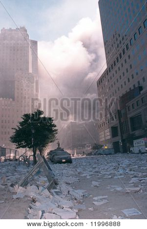 NEW YORK - SEPTEMBER 11:  Smoke lingers in the air and debris litters the area after the collapse of the Twin Towers on September 11, 2001 in New York City.