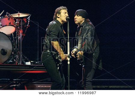 NEW YORK - OCTOBER 4: Singer Bruce Springsteen (L) and Steve Van Zandt, of the E Street Band, perform for their 2002-03 World Tour at Shea Stadium October 4, 2003 in Flushing, New York.