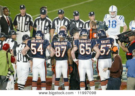 MIAMI - FEB 4: Peyton Manning #18 of the Indianapolis Colts (R) stands on the field during Super Bowl XLI against the Chicago Bears at Dolphins Stadium on February 4, 2007 in Miami, Florida.