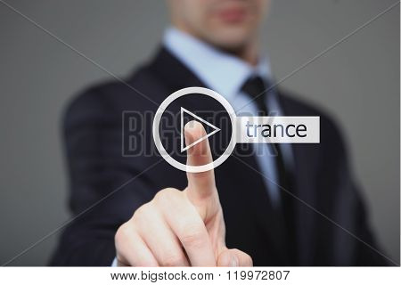 Businessman pressing play trance music button