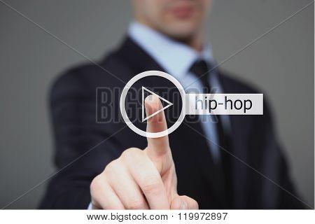 Businessman pressing play hip hop music button