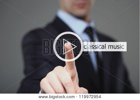 Businessman pressing play classical music button