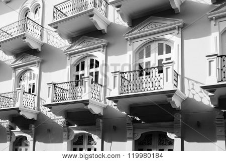 Detail of old balconies balcony on building with decorative windows and doors