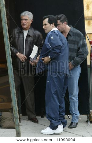 NEW YORK - MAY 15: Actor Frank Vincent (L) waits with other actors to film another scene of The Sopranos on May 15, 2003 in the Queens neighborhood of Whitestone, NY.