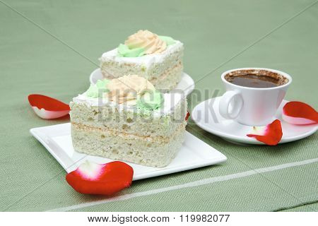 sweet food : milked cream cake with roses and hot black coffee cup
