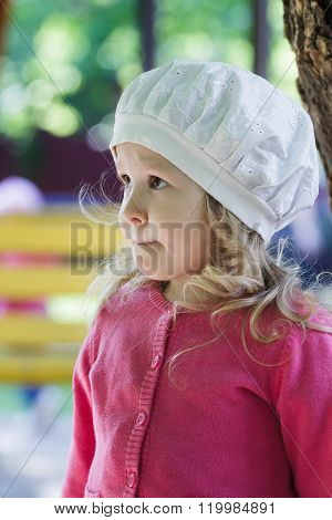 Three years old girl portrait wearing white broderie anglaise fabric beret