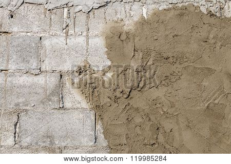 Plasterer Concrete At Wall Of House Construction