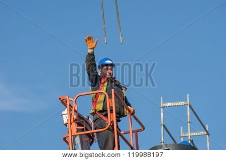 Construction Worker On A Raised Platform