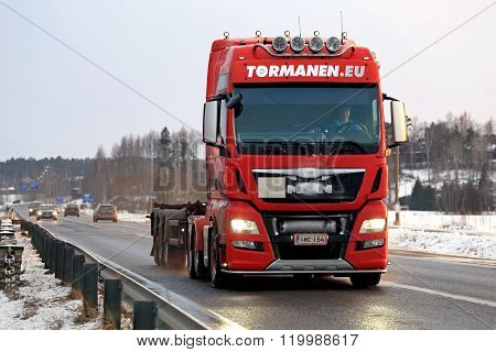 Red MAN Truck Bobtails Along Highway