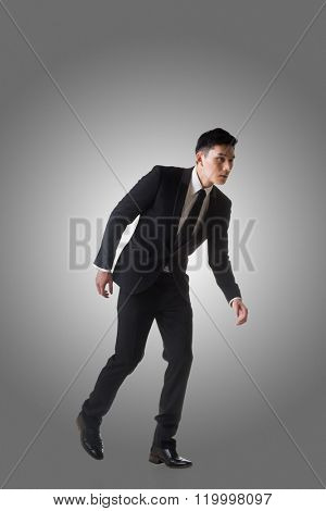 Marionette pose, asian business man isolated