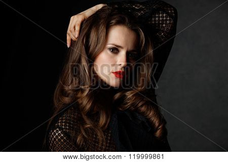 Portrait Of Woman With Long Curly Brown Hair And Red Lips