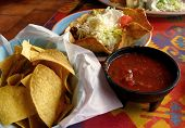 stock photo of mexican food  - tortilla chips salsa and taco salad at a mexican restaurant - JPG