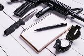 Постер, плакат: Soldier Weapons And Notebook With Pen