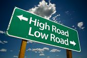 "stock photo of immoral  - ""High Road, Low Road"" Road Sign with dramatic clouds and sky. - JPG"