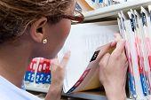 Administrator looking at medical record poster