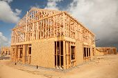 image of subdivision  - Abstract of New Home Construction Site Framing - JPG