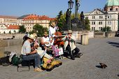 Street musicians playing on a bridge in Prague