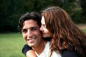 stock photo of married couple  - Hispanic married couple together outside in the fall - JPG