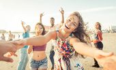 Group Of Friends Having Fun And Dancing On The Beach poster