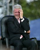 NEW YORK - JUNE 25: Former U.S. President Bill Clinton laughs while attending the Greater New York B