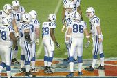 MIAMI - FEB 4: Peyton Manning #18 of the Indianapolis Colts (R) speaks with teammates during Super B