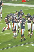 MIAMI - FEB 4: Members of the Chicago Bears jump on the field before playing Super Bowl XLI against