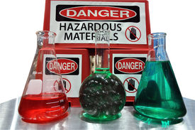 stock photo of pyrex  - A display of medical flask and a Warning message - JPG