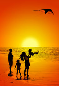 picture of father child  - happy family and a kite on the beach - JPG