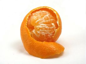 picture of mandarin orange  - a small mandarin orange clementine peeks out from inside its peel - JPG