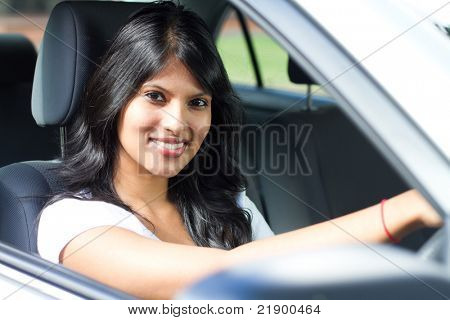 young indian woman driving a car