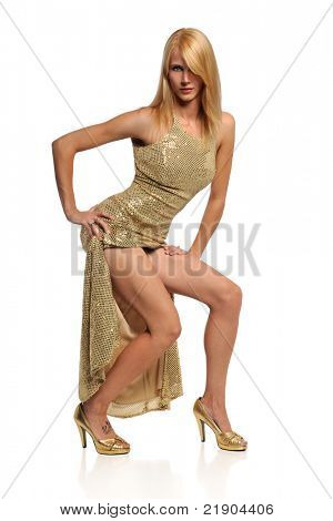 Portrait of beautiful young woman in gold dress isolated over white background