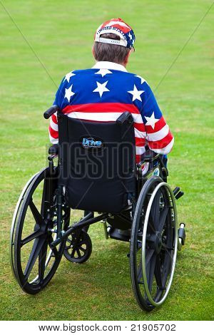 LOS ANGELES, USA - JULY 4 : Disabled American Vietnam veteran in a wheelchair at the Pierce Brothers Westwood Village Memorial Park Cemetery in Los Angeles, USA on July 4, 2011