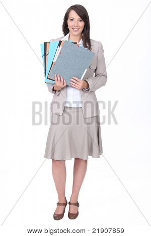 Twenty something dressed for the office with various folders