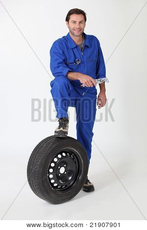 Mechanic with a spare tyre