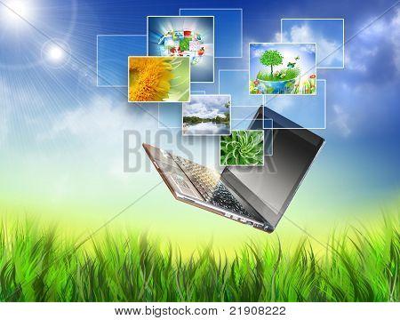 Concepto multimedia portátil moderno en campo verde. Mejor concepto de Internet del negocio global de