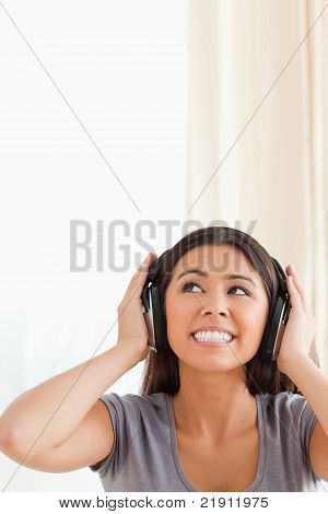 Cute Woman With Earphones Looking Up