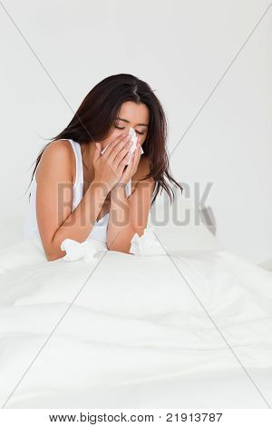 Woman Having A Cold Sitting In Bed