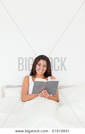 Dark-haired Woman Holding Book