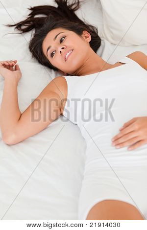 Relaxing Smiling Woman Lying On Bed