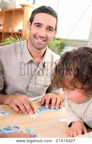 Father and child with jig-saw puzzle