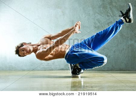 Young strong man break dance.