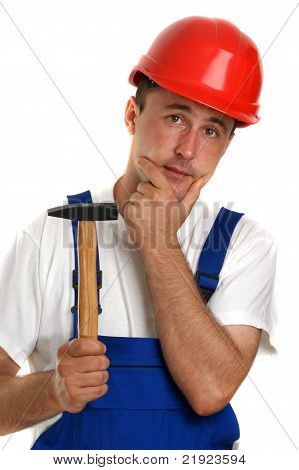 Craftsman With A White T-shirt Holding A Hammer
